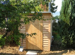 Exterior of compost toilet timber building in Llandinam, Wales
