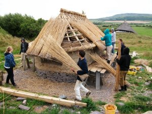 Thatched composting toilet building