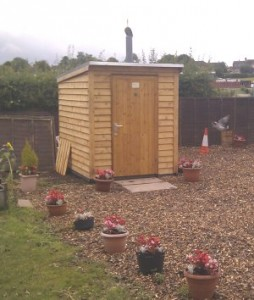 Natsol timber compost toilet in a garden