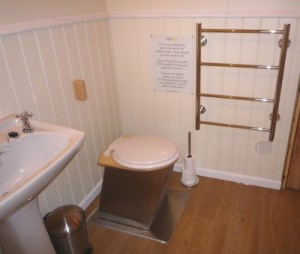 Compact toilet in shepherd's hut