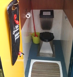 A NatSol Compact toilet in a beach hut.