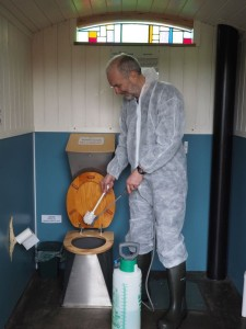 Cleaning a compost toilet pedestal