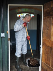 Removing compost from a twin vault compost toilet