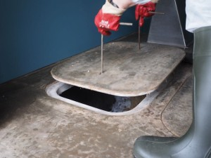 Lifting the floor hatches on a compost toilet