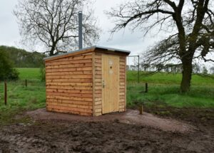 A NatSol Zero Discharge toilet and NatSol timber building on a remote site